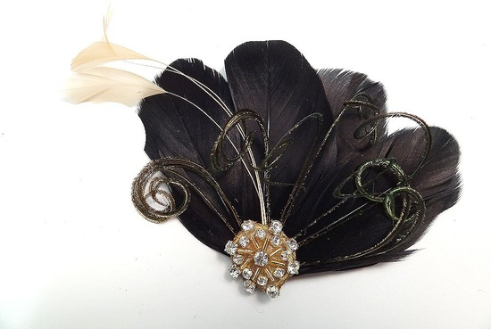 black feather bridal fascinator with gold accents