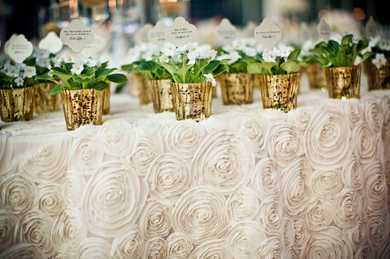 ivory rosette wedding tablecloth with potted gold favors