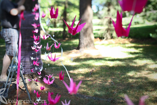 hot pink cranes create a stunning wedding backdrop
