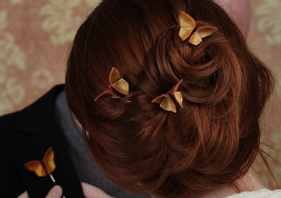 small origami butterflies adorn romantic wedding updo