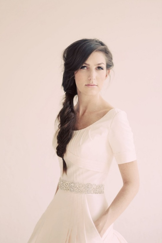 Braided wedding hairstyle, classic wedding dress with sleeves
