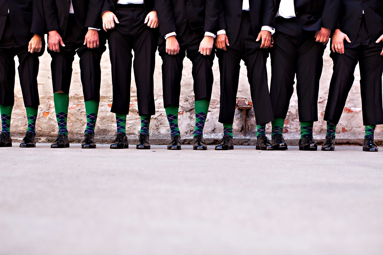 Groom-poses-with-groomsment-in-black-tuxedos.original