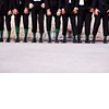 Groom-poses-with-groomsment-in-black-tuxedos.square