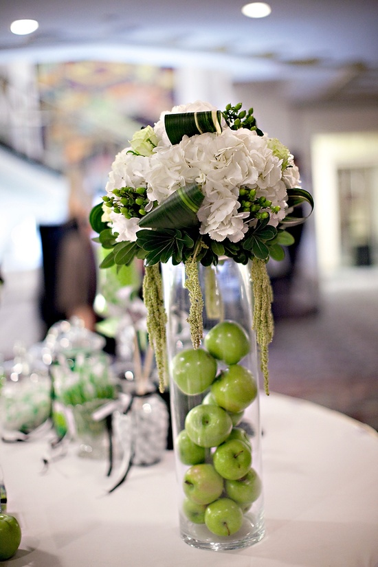 Elegant ivory, green and black wedding reception centerpiece