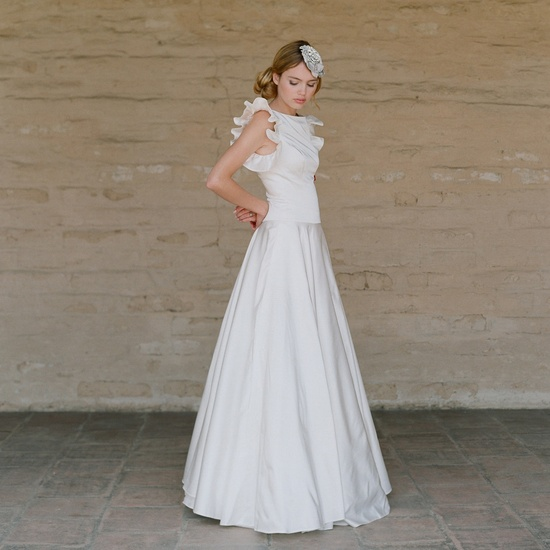 A-line vintage-inspired wedding dress with ruffled sleeves