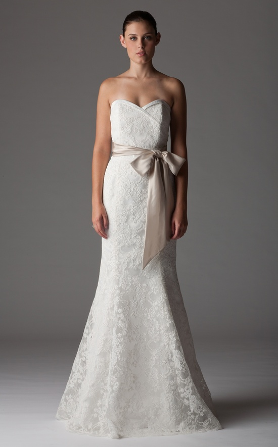 Ivory lace mermaid wedding dress with champagne sash