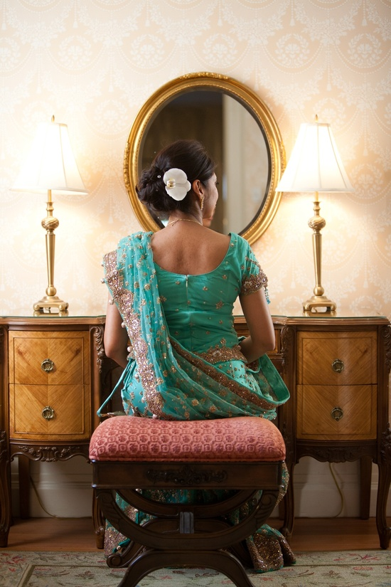 Indian bride wears green wedding sari, all-up wedding hairstyle