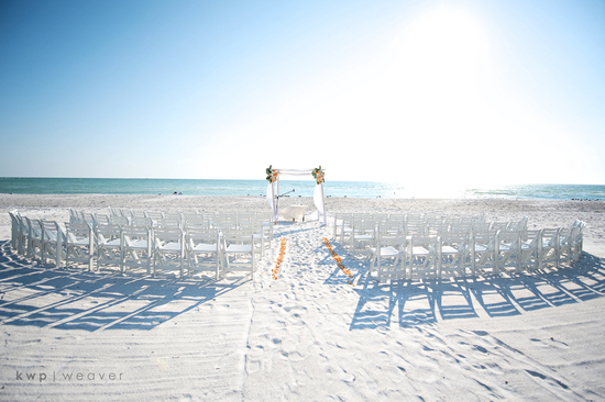Simple outdoor wedding ceremony setup on the beach