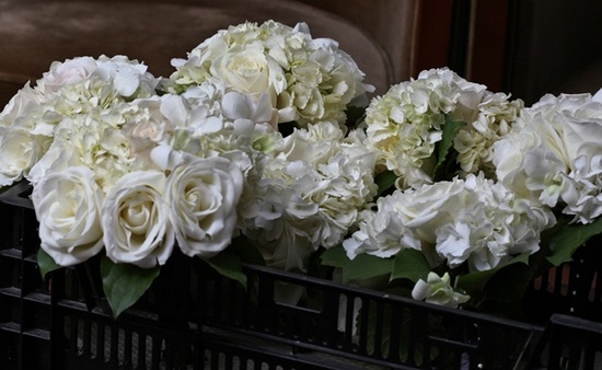 Elegant ivory bridal bouquet with bridesmaids bouquets