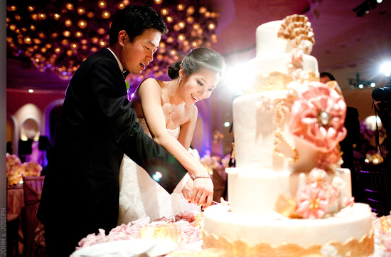 California wedding- Asian bride and groom cut wedding cake
