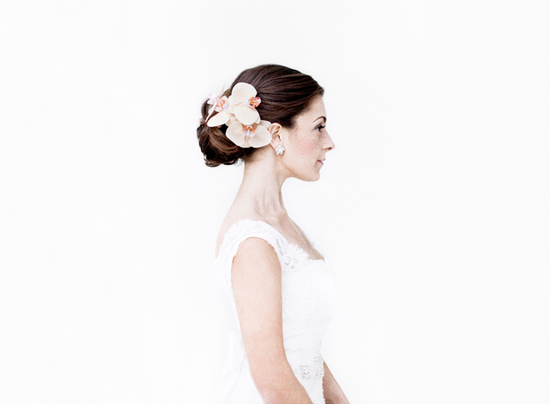 photo of Bridal beauty portraits peach orchids finish a chic wedding updo