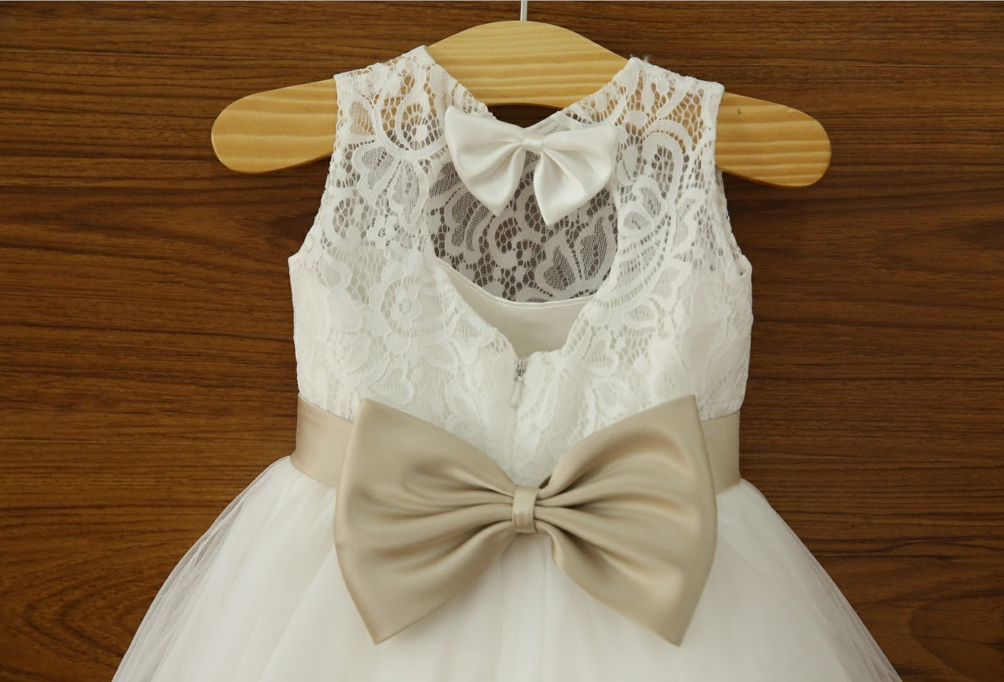 Ivory lace flower girl dress with champagne sash