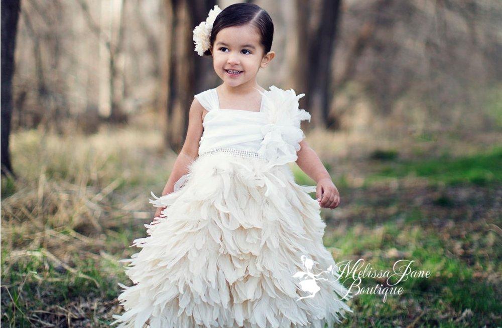Feather-trimmed-flower-girl-dress-in-ivory.full