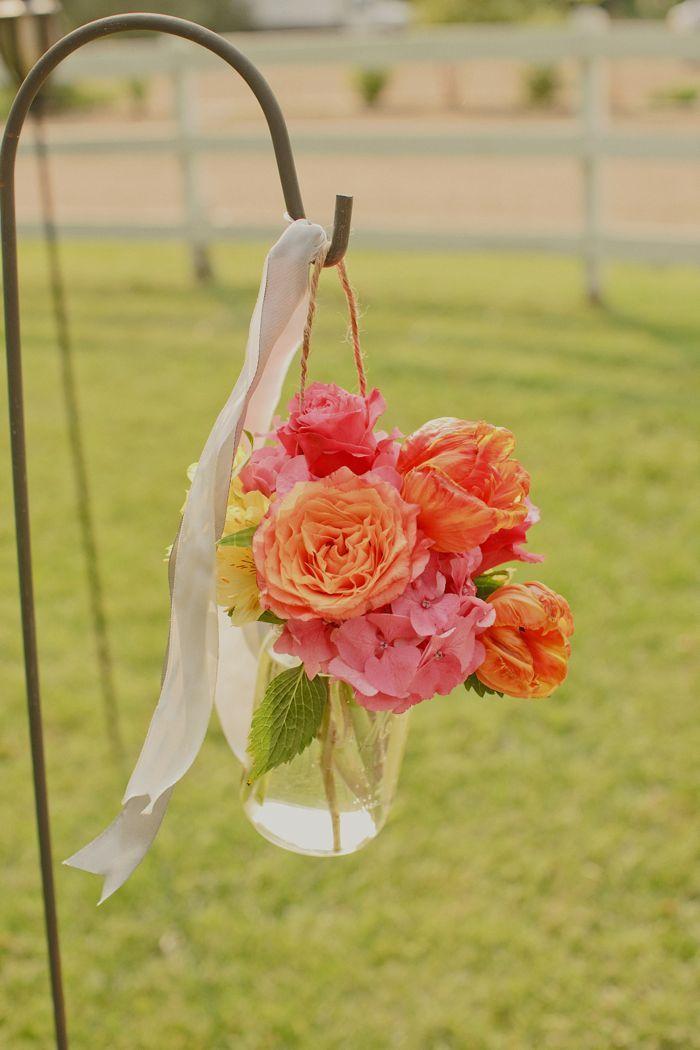 Elegant-outdoor-wedding-colorful-wedding-ceremony-flowers.full