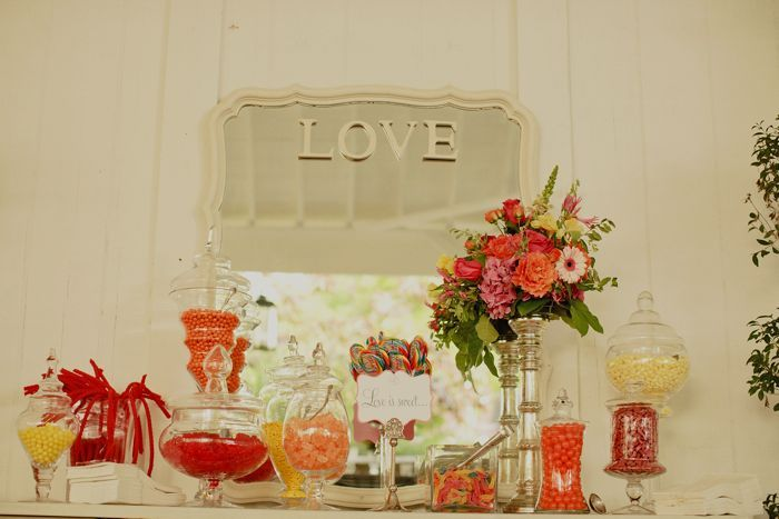 Elegant-real-wedding-candy-bar-wedding-flower-centerpieces.full
