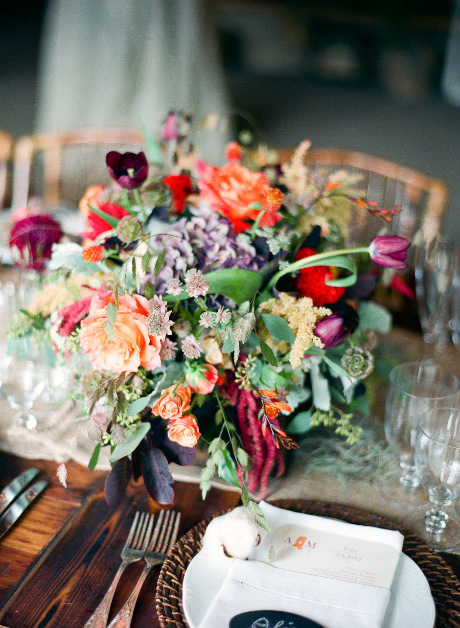 Whimsical-fall-wedding-centerpiece-with-purple-orange-and-red-blooms.full