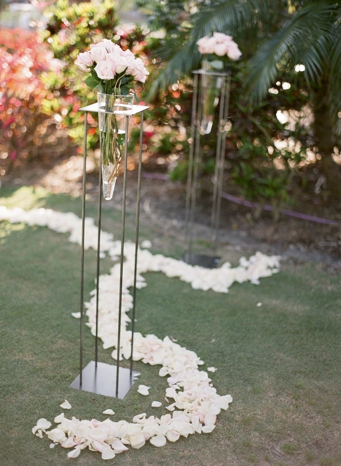 Elegant outdoor wedding ceremony with light pink roses for wedding flowers