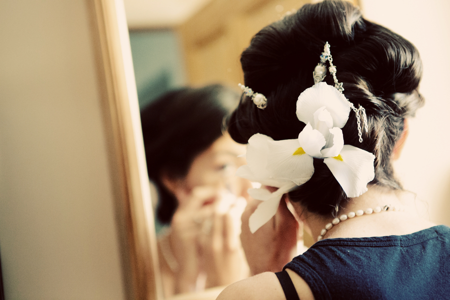 Wedding-updo-finished-with-orchids-and-stands-of-pearls.full