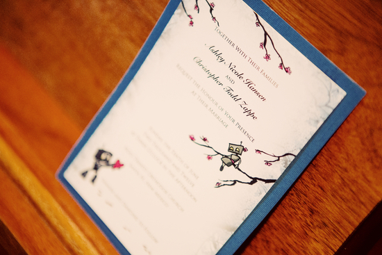 unique wedding invites with tiny robots and cherry blossoms