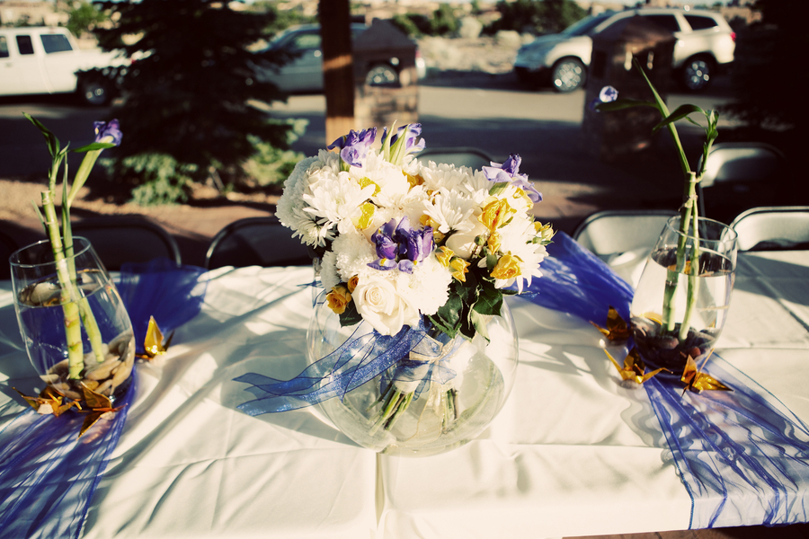 DIY Wedding Centerpieces With White Purple And Yellow Blooms