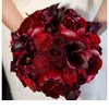 Red-bridal-bouquet-dramatic-wedding-reception-decor.square