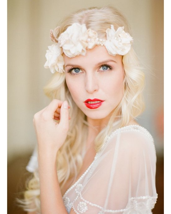 Bohemian bride wears retro red lipstick, long all-dolwn wedding hairstyle