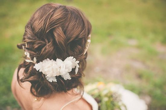 romantic wedding updo with a bohemian floral crown