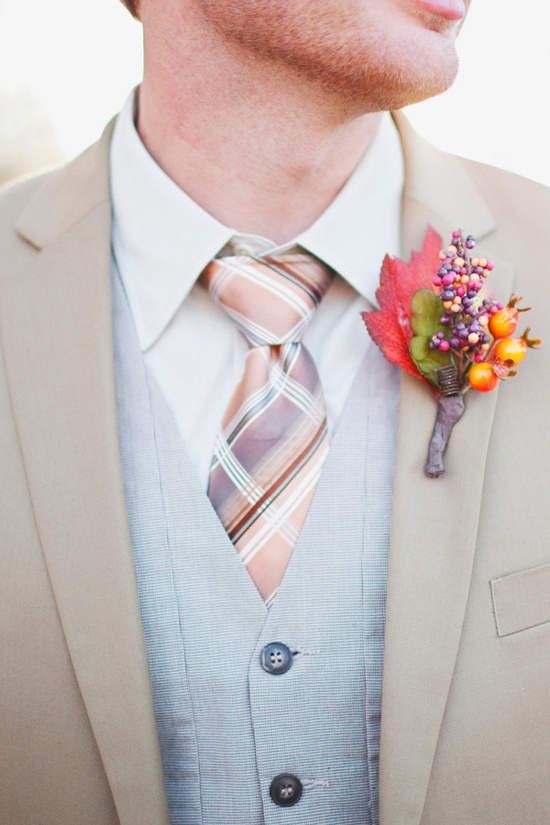 groom wears khaki suit with fabulous fall boutonniere