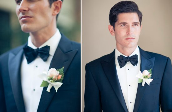 Daper groom wears navy tux and bow tie