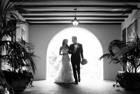 Romantic timeless wedding at the Four Seasons bride and groom make an entrance