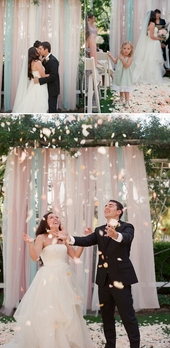 Romantic pale pink and aqua wedding ceremony backdrop