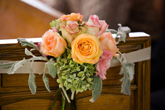 Romantic pink and peach pew flowers