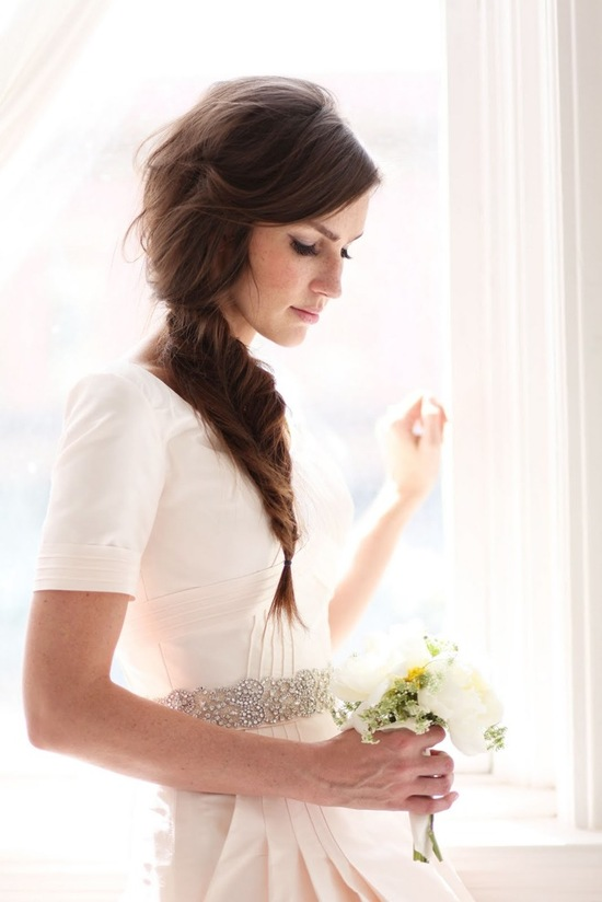photo of Romantic braided wedding hairstyle