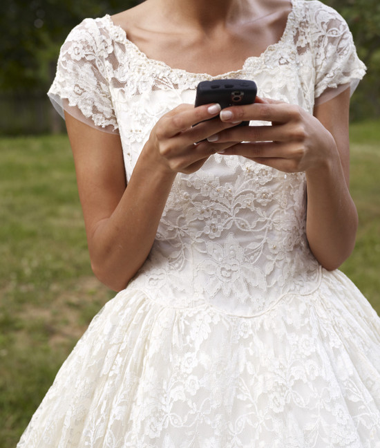 bride on her cell phone wedding dos and donts