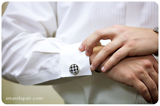 groom wears black and white houndstooth cuff links