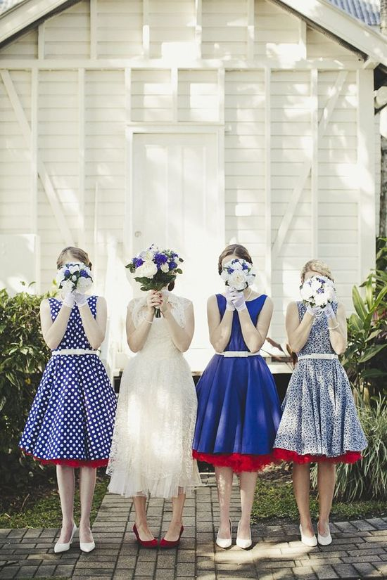 photo of mix and match bridesmaids in blue and ivory