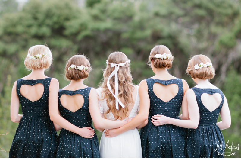 Bridesmaids-wear-navy-and-white-polka-dot-dresses-with-heart-shaped-open-backs.full