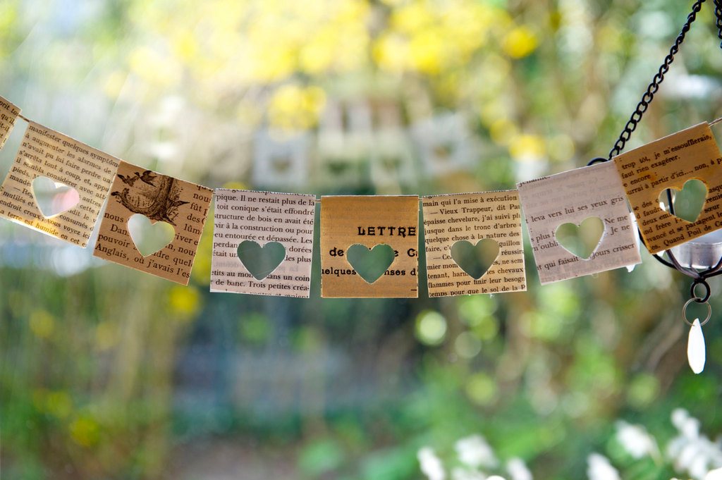 recycled paper wedding garland with cutout hearts