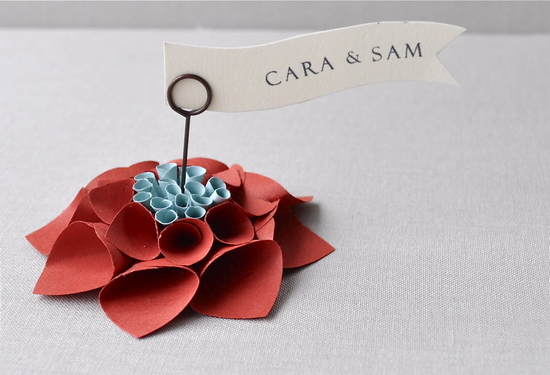 paper flower wedding escort card holder in red and pale blue