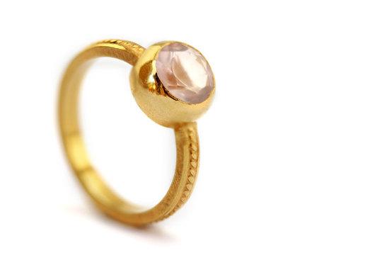 photo of rose quartz eco friendly engagement ring for romantic brides