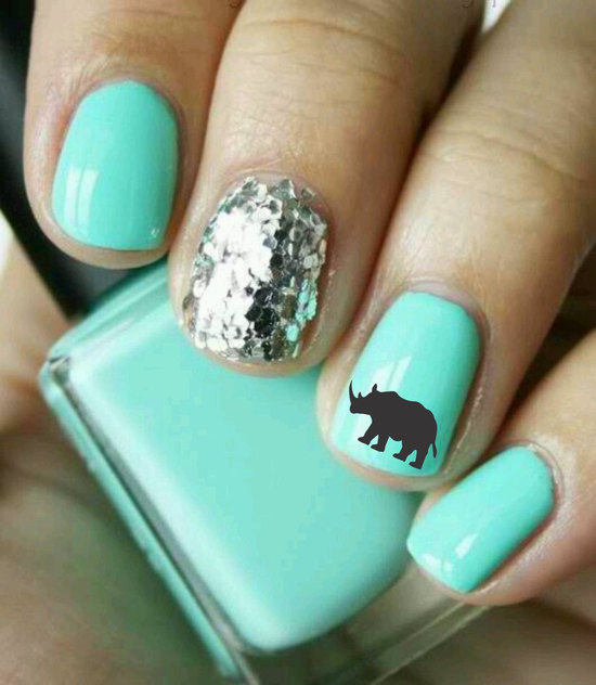 photo of turquoise wedding nails with silver glitter and fun silhouette