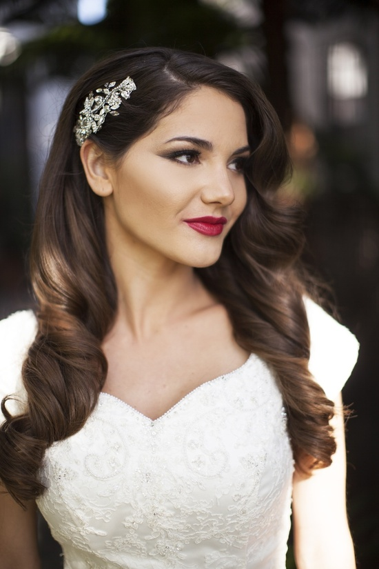 Old Hollywood bride wears half up wavy hairstyle and red lips