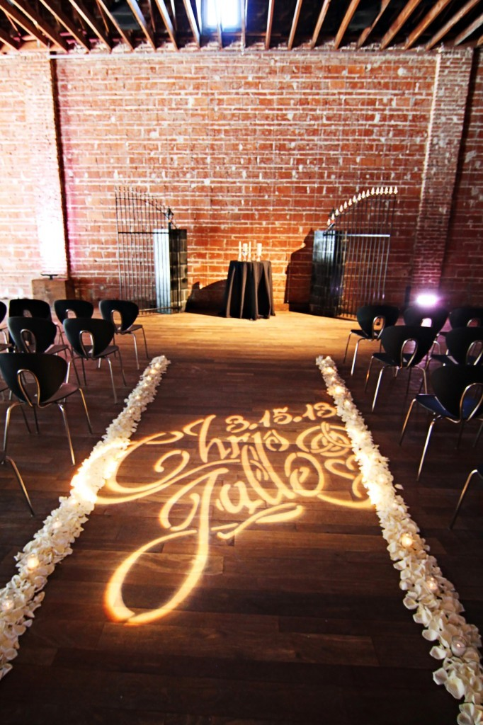 & custom wedding monogram lighting on ceremony aisle
