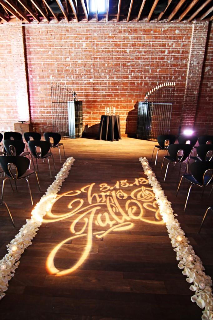 Custom-wedding-monogram-lighting-on-ceremony-aisle.full