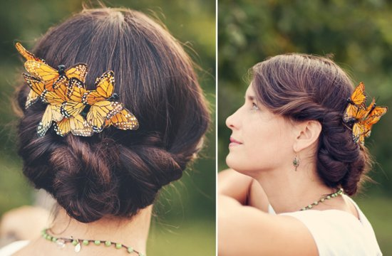 twisted wedding updo with butterfly accents