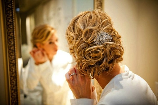 side parted curly wedding updo with crystal comb