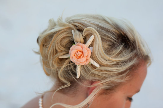 Softly swept wedding updo for beach brides