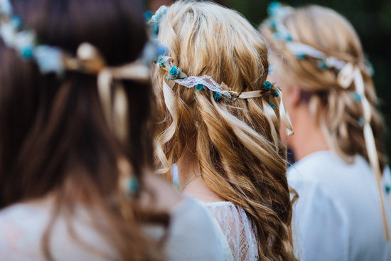 Bohemian wedding ceremony with bridesmaids in lace and floral crowns