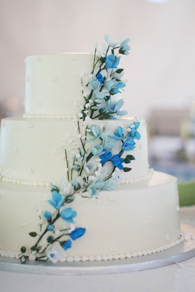 Classic white wedding cake with blooming branches design ...