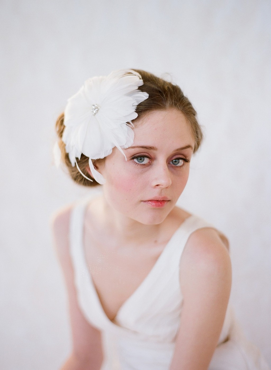 Romantic feather fascinators for brides-to-be
